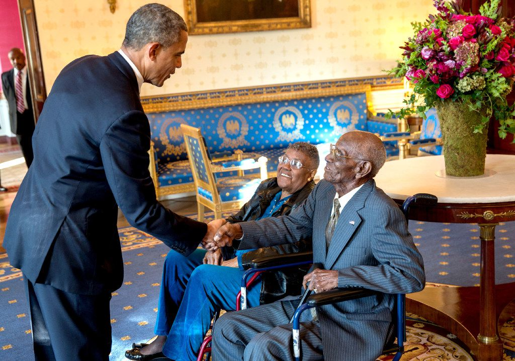 President Barack Obama greets Richard Overton, with Earlene Love-Karo, in the Blue Room of the White House on Nov. 11, 2013, when he was 107.