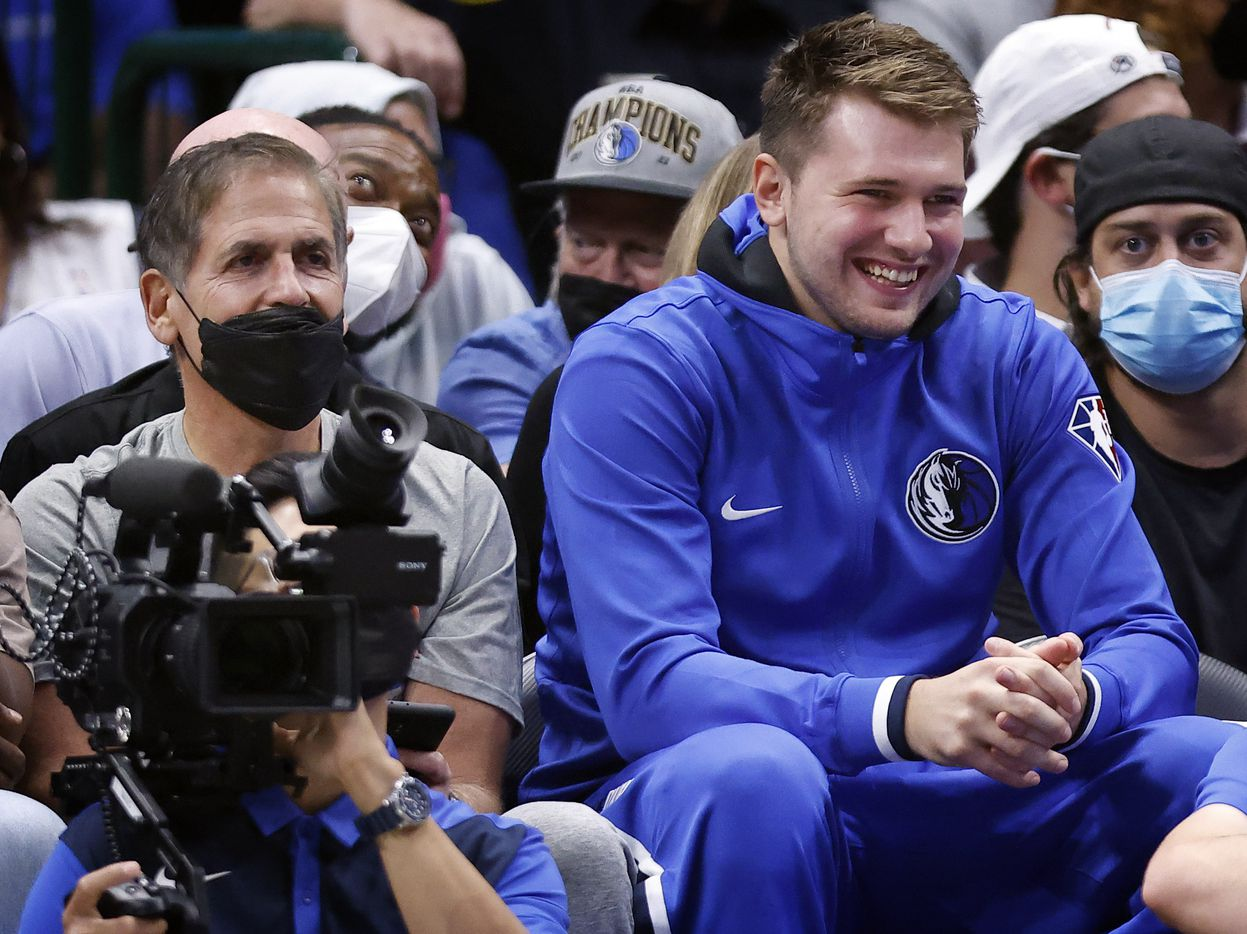 Dallas Mavericks guard Luka Doncic watches the second half from the bench with owner Mark Cuban at the American Airlines Center in Dallas, Wednesday, October 6, 2021. The Mavericks defeated the Jazz, 111-101. (Tom Fox/The Dallas Morning News)