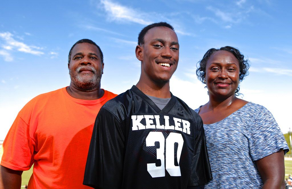 K.L. Norwood, 18, center, poses for a photo with his parents Kemper Norwood Sr. and Linda Norwood during the Special Olympics Greater Fort Worth Area 2016 Flag Football Competition at Keller High School, Saturday, October 1, 2016. (Brandon Wade/Special Contributor)