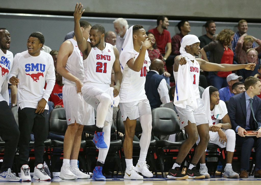 Southern Methodist Mustangs guard Ben Emelogu II (21), guard Jarrey Foster (10) and guard Shake Milton (1) celebrate a shot by guard James Pyle (12) in the second half during an NCAA basketball game between the Northwestern State and SMU at Moody Coliseum on the campus of Southern Methodist University in Dallas Wednesday November 15, 2017. SMU beat Northwestern State Demons 81-35. (Andy Jacobsohn/The Dallas Morning News)