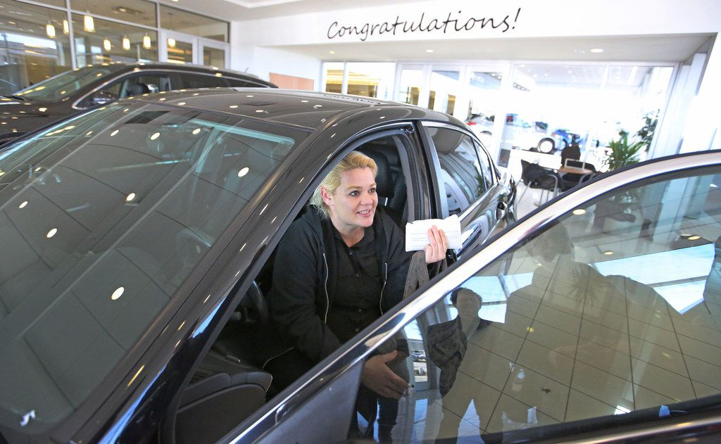 Christal Scott reacts to receiving a 2012 Honda Accord in a ceremony at Ewing Buick dealership in Plano on Jan. 16, 2018. The Watchdog wrote about  Christal, a single mom waitress, who lost her car to another auto dealership's repossession and had to go to court for resolution.