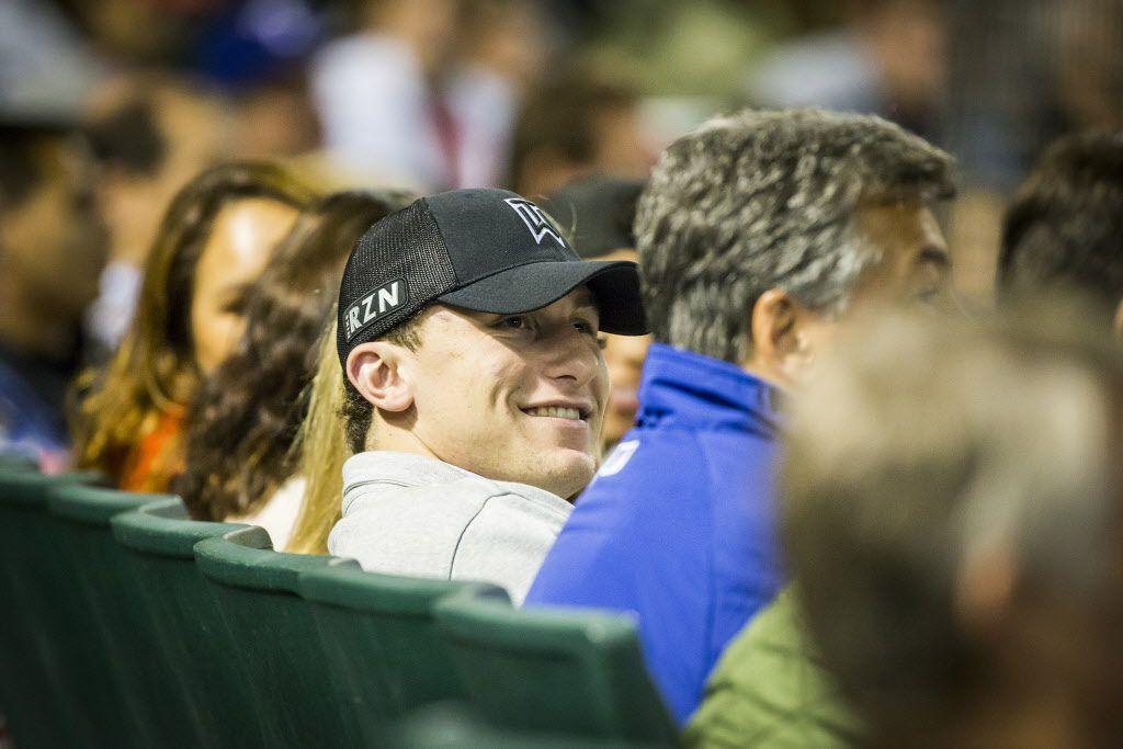 Johnny Manziel watches from the seats behind home plate as the Texas Rangers face the Los Angeles Angels at Globe Life Park on Tuesday, April 14, 2015, in Arlington. (Smiley N. Pool/The Dallas Morning News) [ 2015PUB - 2015APRIL ] 04192015xSPORTS