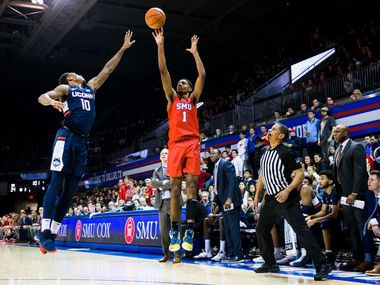 Southern Methodist Mustangs forward Feron Hunt (1) makes a three pointer over Connecticut Huskies guard Brendan Adams (10) during the first half of an NCAA basketball game between SMU and UConn on Wednesday, February 12, 2020 at Moody Coliseum on the SMU campus in Dallas.