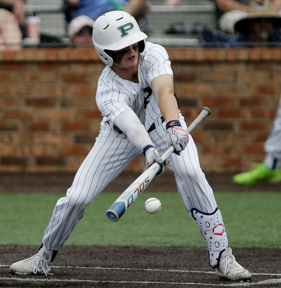 Prosper outfielder Jacob Nelson (19) bunts in the fifth inning as Prosper High School hosted Arlington Martin High School in a series final 6A Region I area round playoff game on Saturday afternoon, May 15, 2021. (Stewart F. House/Special Contributor)