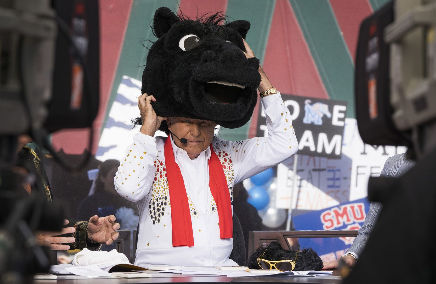 Lee Corso dons the headgear of SMU mascot Peruna as he picks the Mustangs for victory over Memphis during ESPN College GameDay on Saturday, Nov. 2, 2019, in Memphis, Tenn.