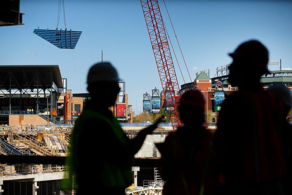 A large piece of decking is moved by a crane during a press event at the new Globe Life Field under construction in Arlington, Texas, Tuesday, September 18, 2018.