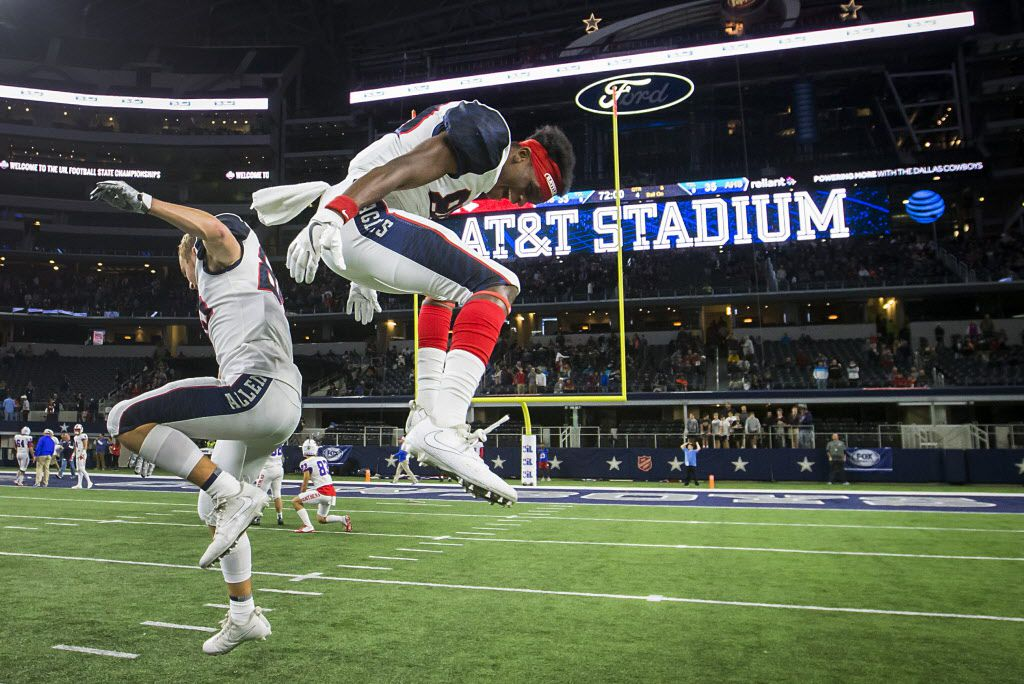 Allen wide receivers Ja'Juan Mason (right) and David Christopherson (85) celebrate after the Eagles 35-33 victory over Lake Travis in the Class 6A Division I state championship game at AT&T Stadium on Saturday, Dec. 23, 2017, in Arlington, Texas. (Smiley N. Pool/The Dallas Morning News)