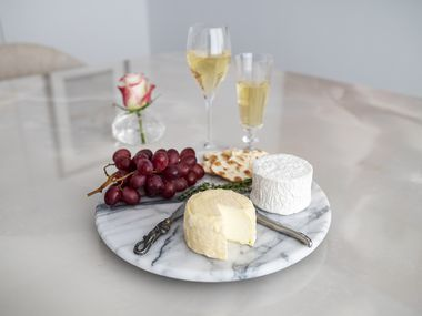 Haute Goat's Chaource, made in Longview, bottom center, and Cowgirl Creamery Mt. Tam triple cream cheese, paired with a brut Champagne and a California sparkling wine