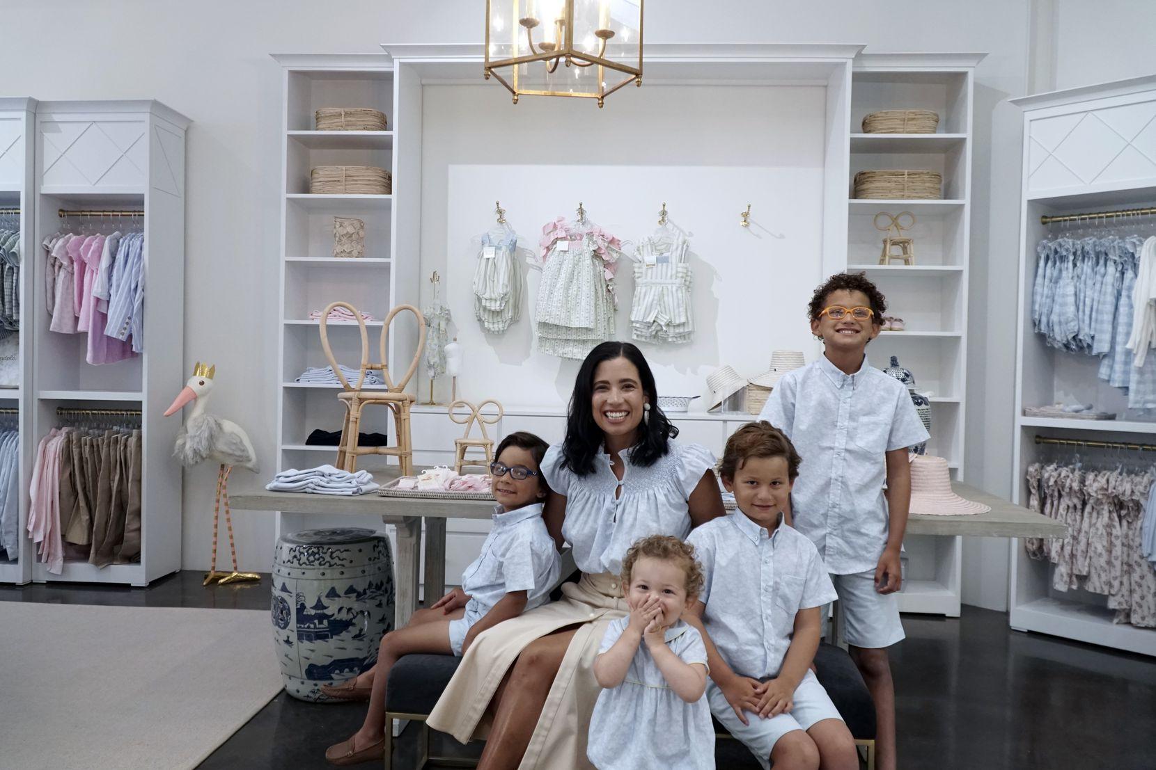Dondolo owner Catalina Gonzalez gathers with her children Luis Jorba (from left), 5; Roberto Jorba, 2; Jaime Jorba,7; and Santiago Jorba, 10, at her store in Dallas.