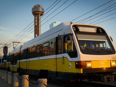 A DART rail Blue Line train heads away Union Station in front of Reunion Tower on Friday, July 31, 2020.