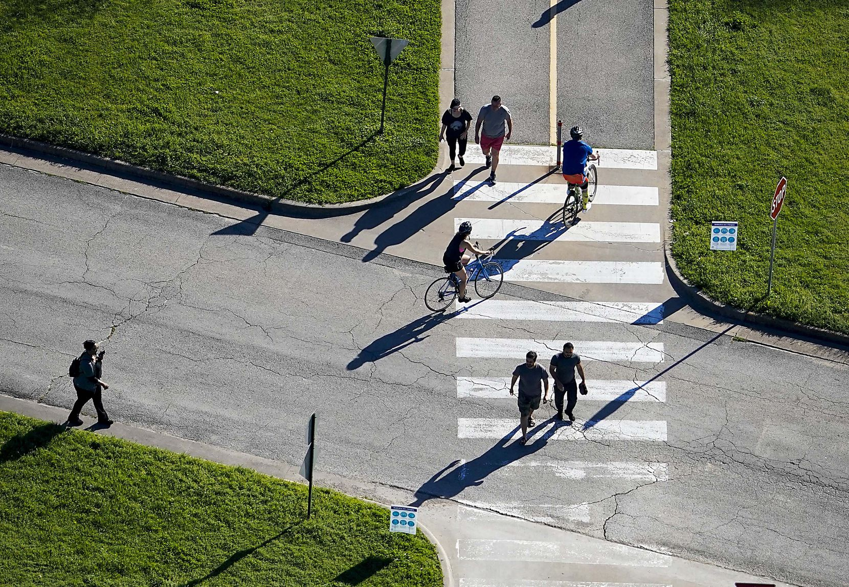 Aerial view of people cycling, walking and jogging on a trail at White Rock Lake in Dallas on Tuesday, March 24, 2020. With social distancing the norm now due to the new coronavirus, 'for the first time ever, we have to ask people not to come to the trail for their safety,' said Paula Grunow, development and operations assistant for the nonprofit Friends of the Katy Trail.