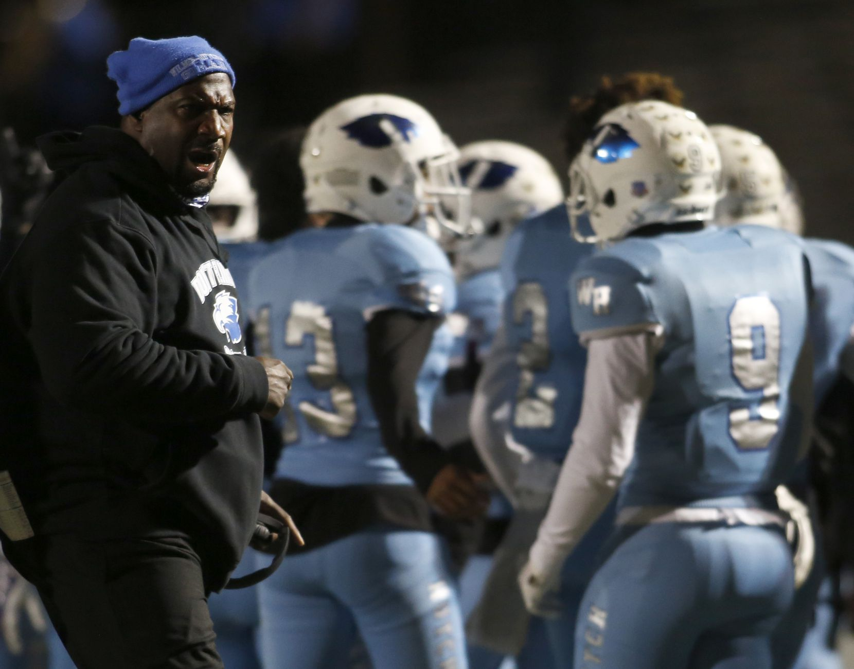 Wilmer Hutchins head coach Elzie Barnett Sr. shares some coaching feedback following an Eagles touchdown during first half action against Dallas Carter. The two teams played their District 8-4A Division 1 football game at Wilmer Hutchins High School Stadium in Dallas on October 23, 2020. (Steve Hamm/ Special Contributor)