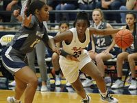 Frisco Liberty High School guard Journee Chambers (23) drives to the basket as she is defended by Wylie East High School guard Keyera Roseby (10) during the first half as Frisco Liberty High School hosted Wylie East High School in the girls basketball Class 5A Region II final at McKinney High School on Tuesday, March 2, 2021.