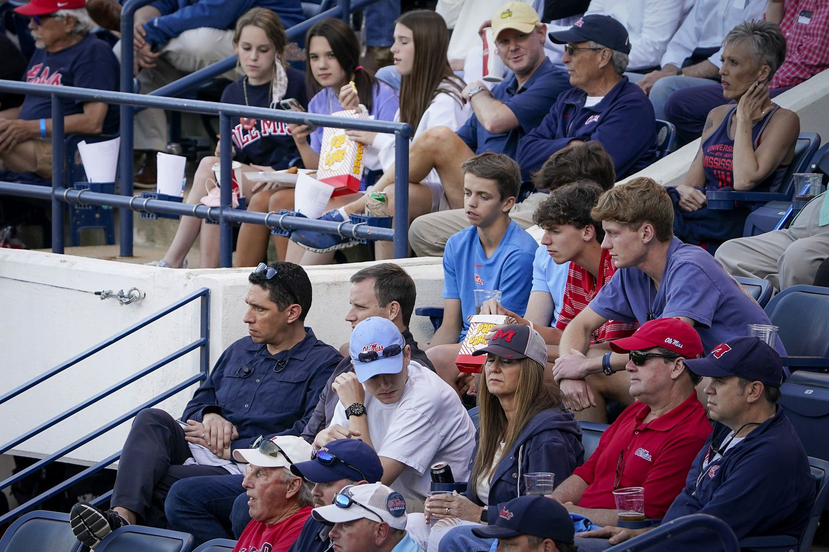 Texas Ranges president, baseball operations, Jon Daniels (bottom left) watches an NCAA baseball game between Mississippi and Vanderbilt at Swayze Field on Friday, May 14, 2021, in Oxford, Miss.
