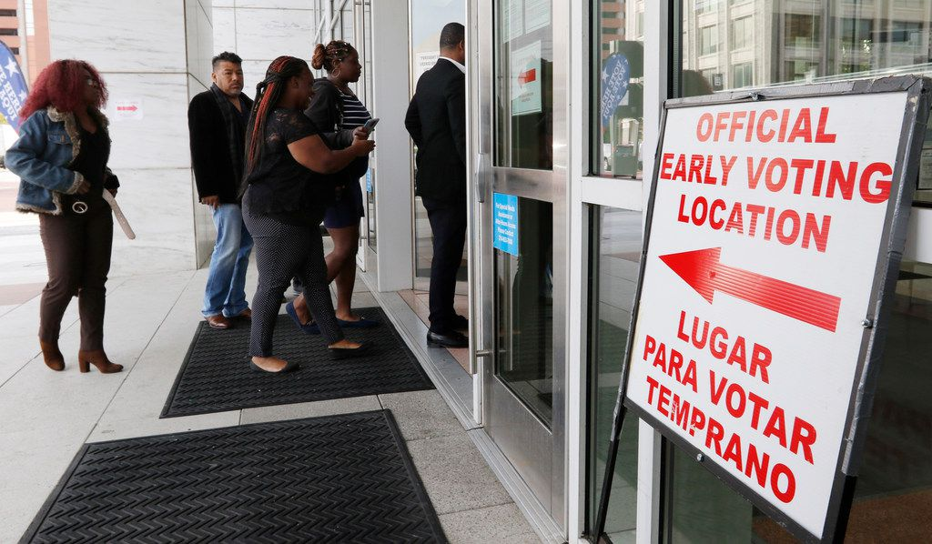 People walk into the George L. Allen, Sr. Courts Building in Dallas at 600 Commerce St on Oct. 22, 2018. Early voting started today.