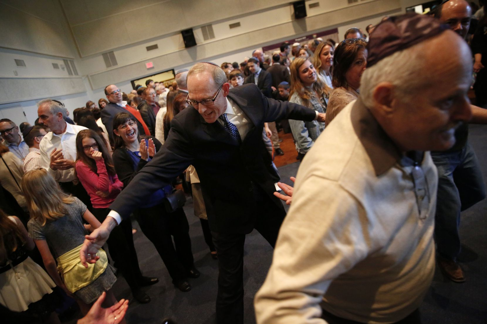 Rabbi Stefan Weinberg encourages congregants to dance in celebration of the arrival of the new torah honoring his late wife, Wende Weinberg, at Anshai Torah in Plano.