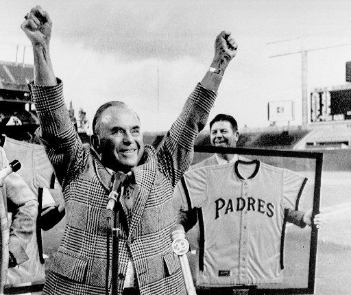 Ray Kroc, then owner of the San Diego Padres, acknowledges applause before the  season opener in this file photo taken  April 10, 1974