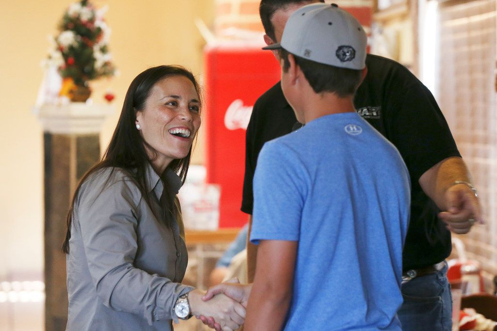 Democratic nominee for Texas' U.S. Congressional District 23 Gina Ortiz Jones greets patrons as she arrives for a meet-and-greet reception at El Charro Restaurant in Hondo, Texas, on Aug. 1, 2018.