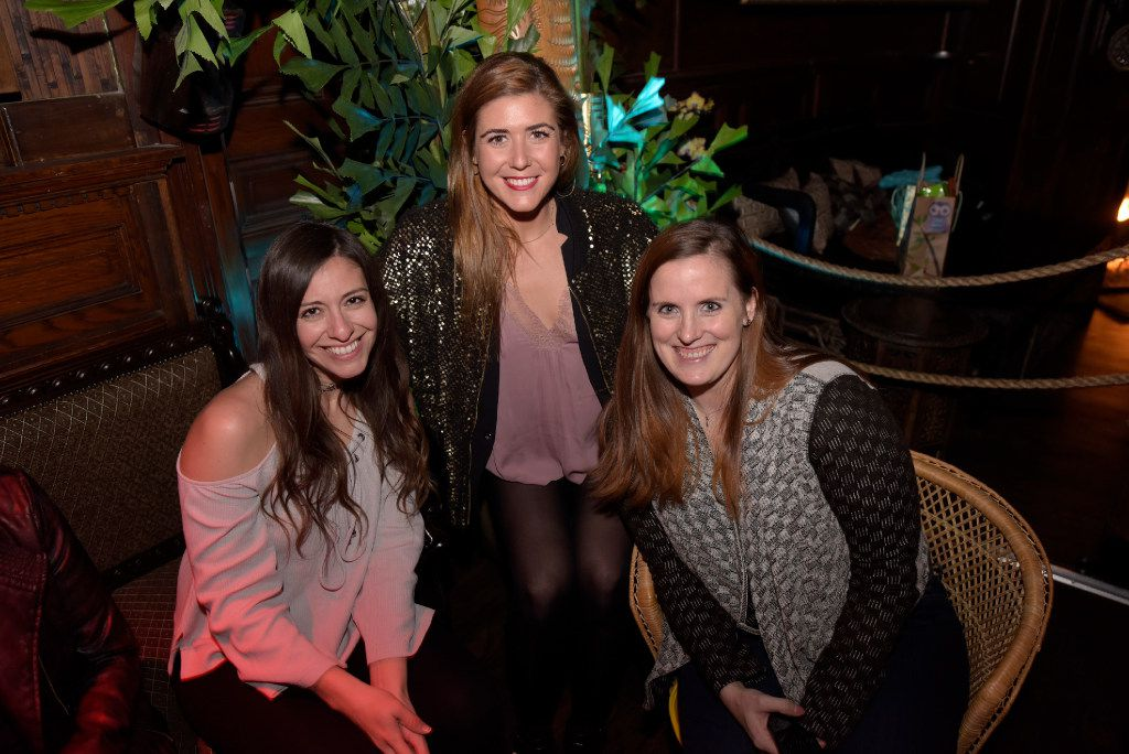 Kristi Duckworth, left, Katie Clawson, center, and Sara Segarra enjoy a night at Pilikia, a tiki bar on Ross Ave., open in the former Three Sheets location.