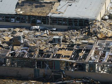 Tornado damage is seen an aerial view of Thomas Jefferson High School on Monday, Oct. 21, 2019, in Dallas.