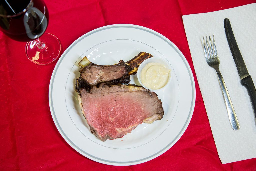 A single serving of a crown roast paired with horseradish sauce