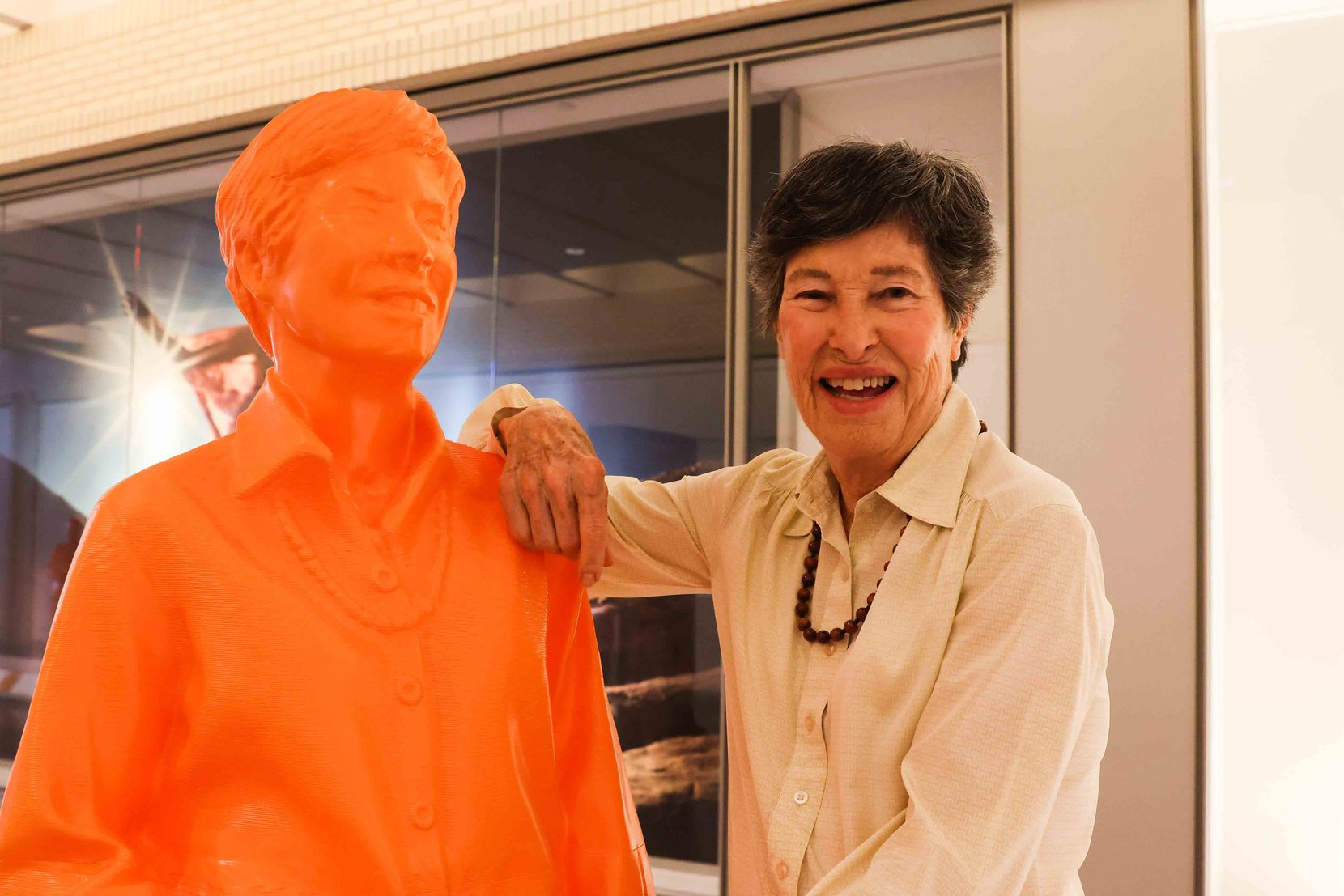Lyda Hill, founder of LH Capital Inc., poses next to her own sculpture in the exhibit at NorthPark.