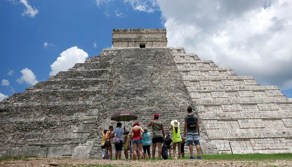 Tourists are dwarfed by El Castillo at the Chichen-Itza ruins in Yucatan, Mexico. While beach destinations remain popular for spring break, travel agents say customers are also demanding unique cultural experiences and active outdoorsy adventures.
