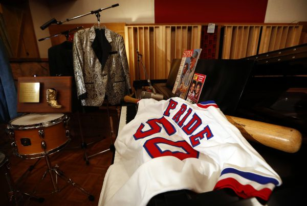 Country star Charley Pride's Texas Rangers jersey and baseball bat are part of his collection of memorabilia being donated to the Smithsonian's National Museum of African American History and Culture,. He is photographed at his Dallas studios, Monday, September 24, 2012.