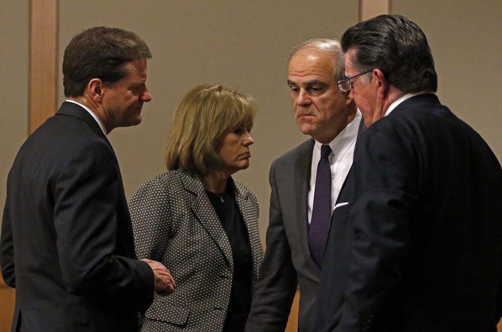 Members of the Texas Attorney General Ken Paxton defense team, Bill Mateja, left, Terri Moore, second from left, Philip Hilder, second from right, and Dan Cogdell gather during a pre-trial motion hearing at the Collin County courthouse on Tuesday, Dec. 1, 2015, in McKinney, Texas. (Jae S. Lee/The Dallas Morning News)
