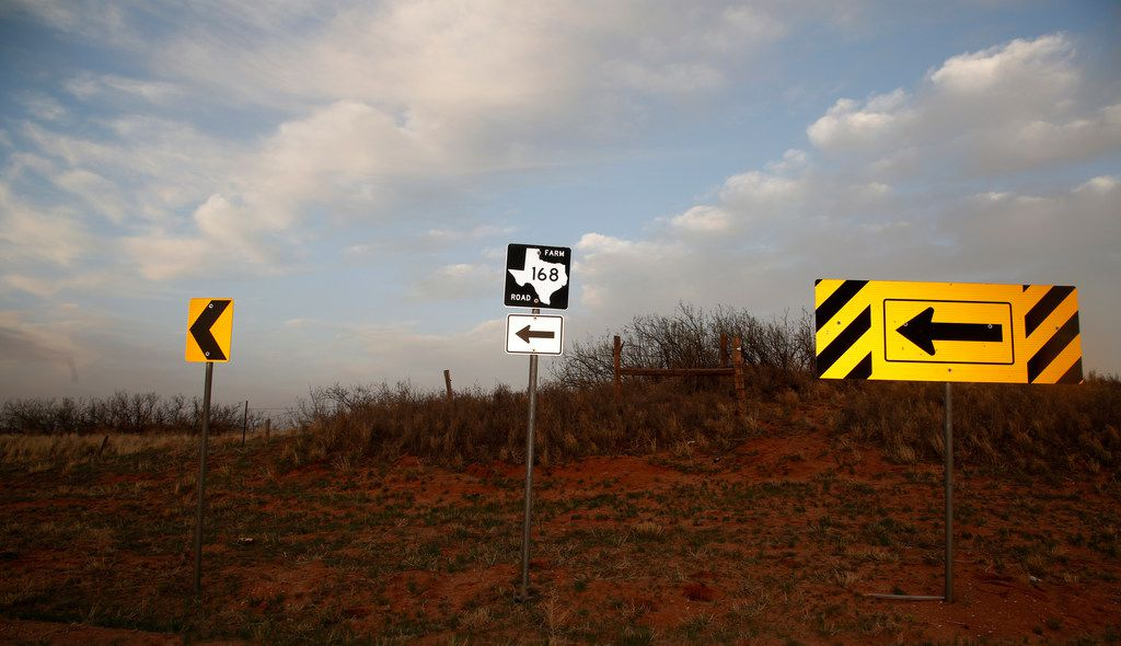 Directional signs point north where FM 168 begins at the junction with FM 1076 in Terry County west of Lubbock April 17, 2018. (File Photo/Staff)