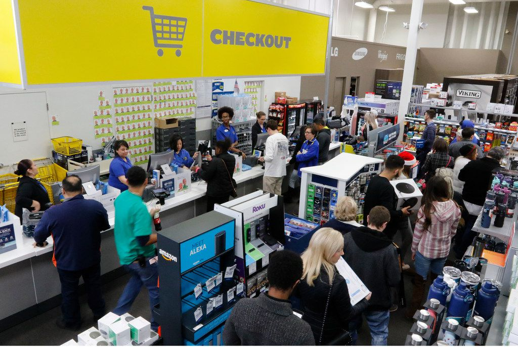 The checkout line at Best Buy was packed throughout the day as customers did last-minute Christmas Eve shopping at the store on North Central Expressway.