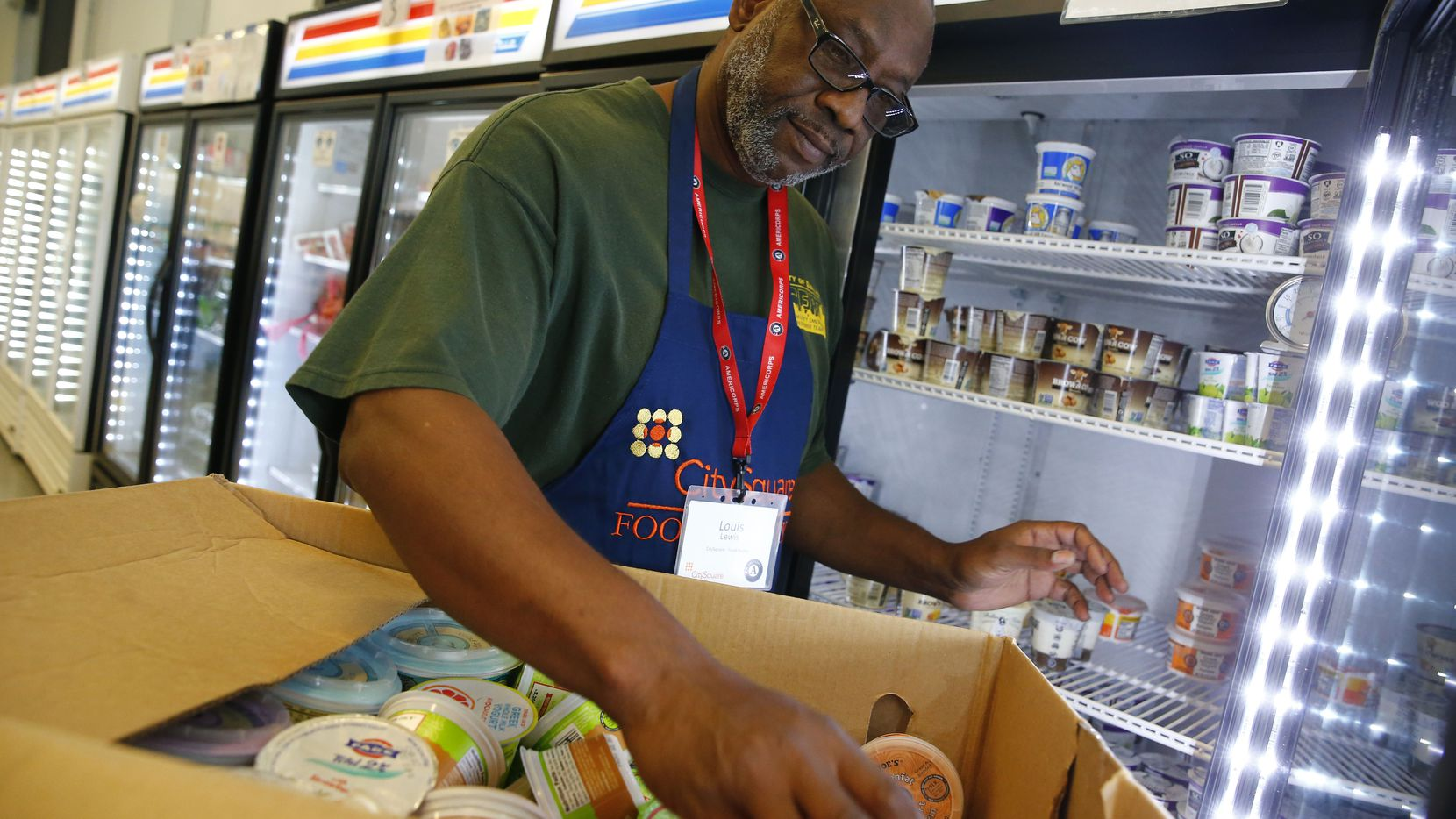 Volunteer Louis Lewis organized yogurt at the CitySquare Opportunity Center food pantry in Dallas in November 2017. The center needs both onsite and virtual volunteers.