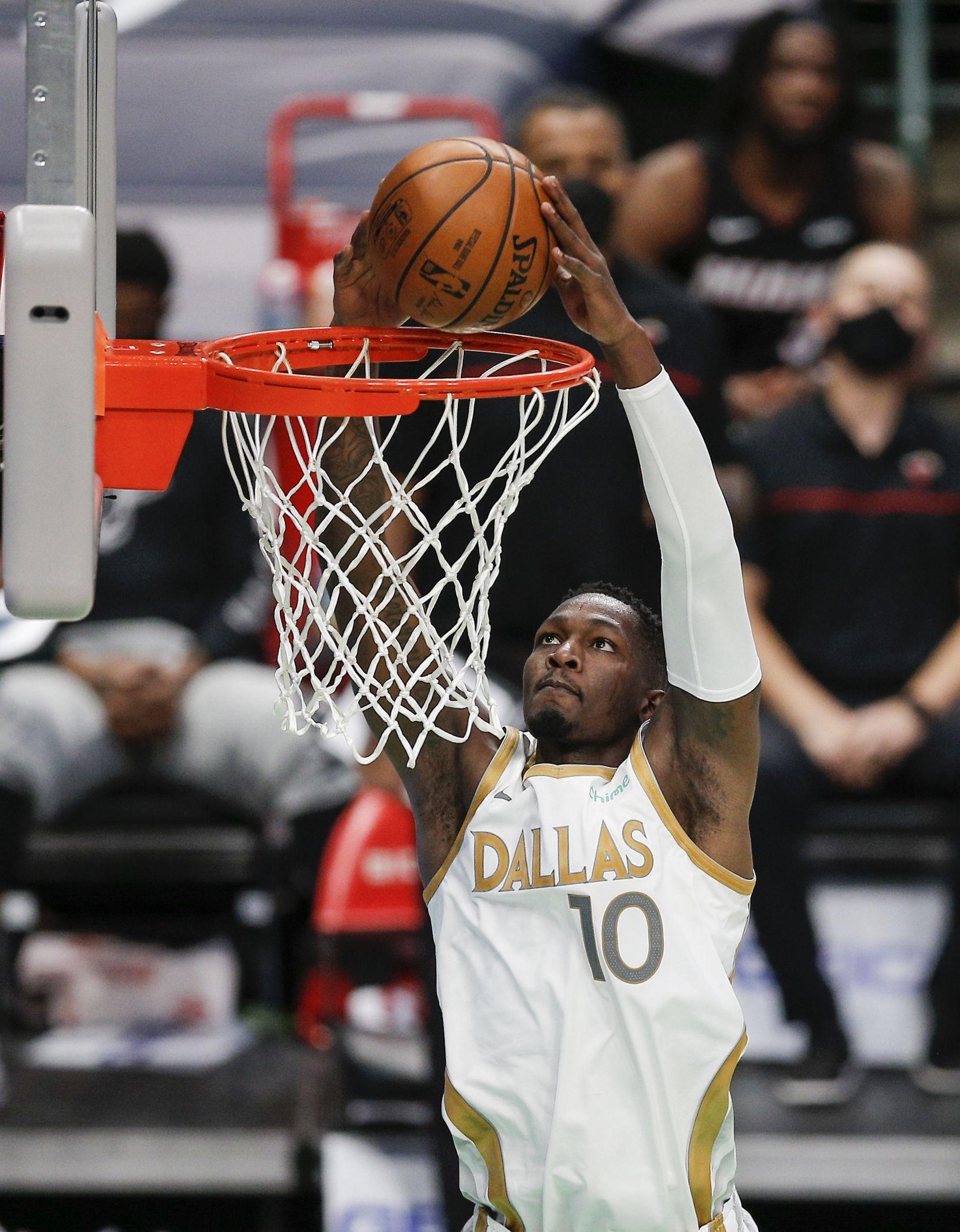 Dallas Mavericks forward Dorian Finney-Smith (10) dunks during the second half of an NBA basketball game against the Miami Heat, Friday, January 1, 2021.  Dallas won 93-83. (Brandon Wade/Special Contributor)