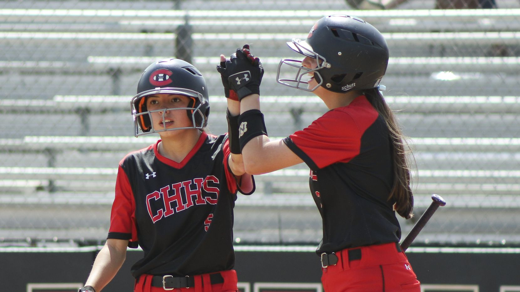 Colleyville Heritage second baseman Leah Perales (5) high fives catcher Alexis Perales (3) after the game-winning run during a softball Class 5A area-round playoff game against Mansfield Legacy in Colleyville, Texas on Saturday, May 8, 2021.