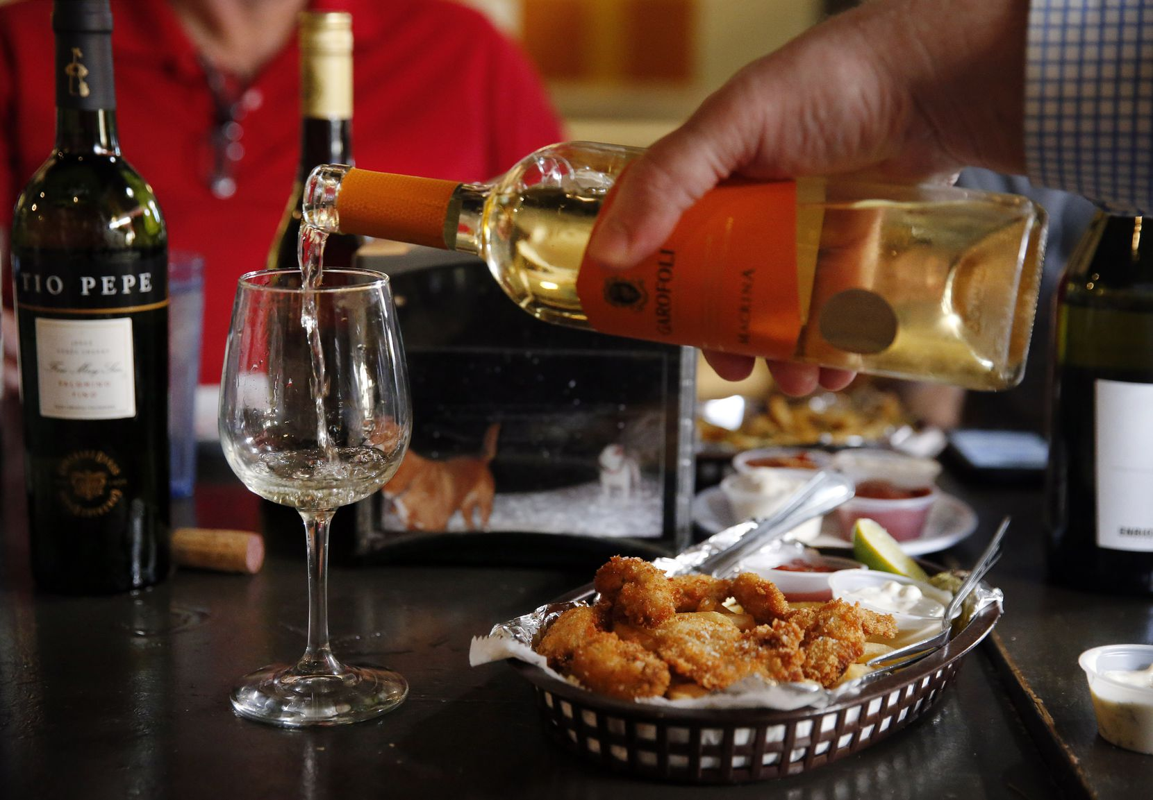 The Dallas Morning News wine panel paired wine with entrees from 20 Feet Seafood on Peavy Road in Dallas. They paired wines with various dishes, such as fried Ipswich whole belly clams, Blue Point oysters and fish & chips.  (Tom Fox/The Dallas Morning News)
