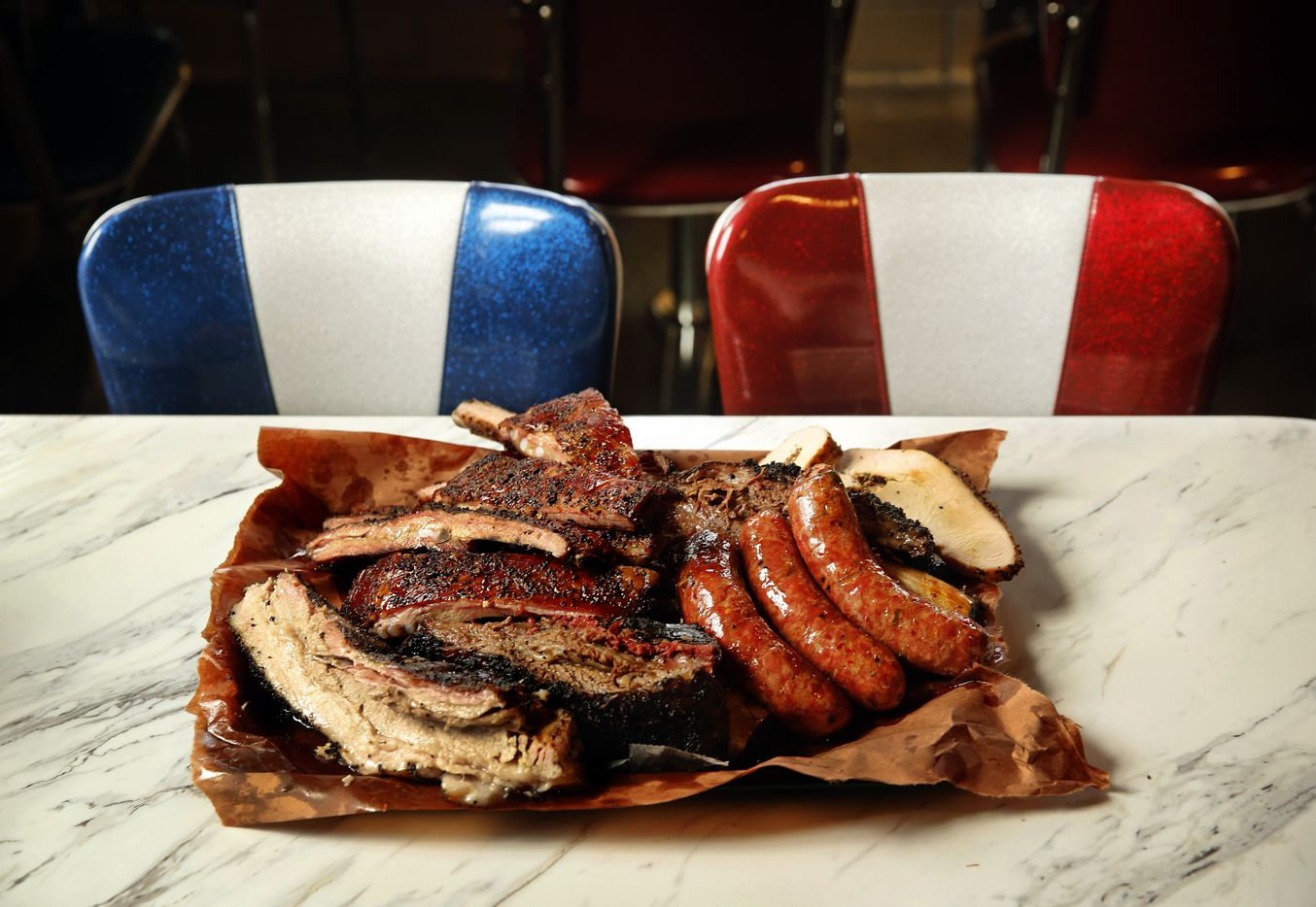 A full platter of smoked turkey, pork ribs, brisket, beef ribs, sausage, and pork belly are served up at Killen's BBQ in Pearland, Texas, Saturday, June 28, 2014. (Tom Fox/The Dallas Morning News) 08032014xTRAVEL 08102014xTRAVEL
