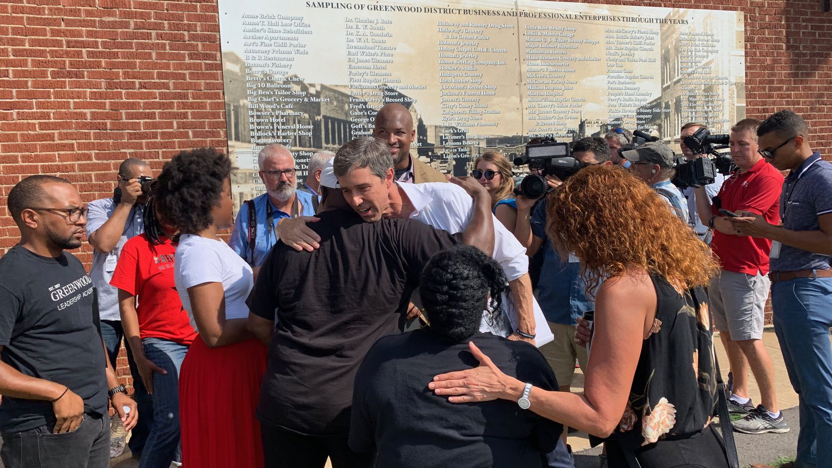 Democratic presidential hopeful Beto O'Rourke hugs a community activists during his tour of the Greenwood neighborhood in Tulsa. The once affluent black community was overrun by a white mob in 1921.