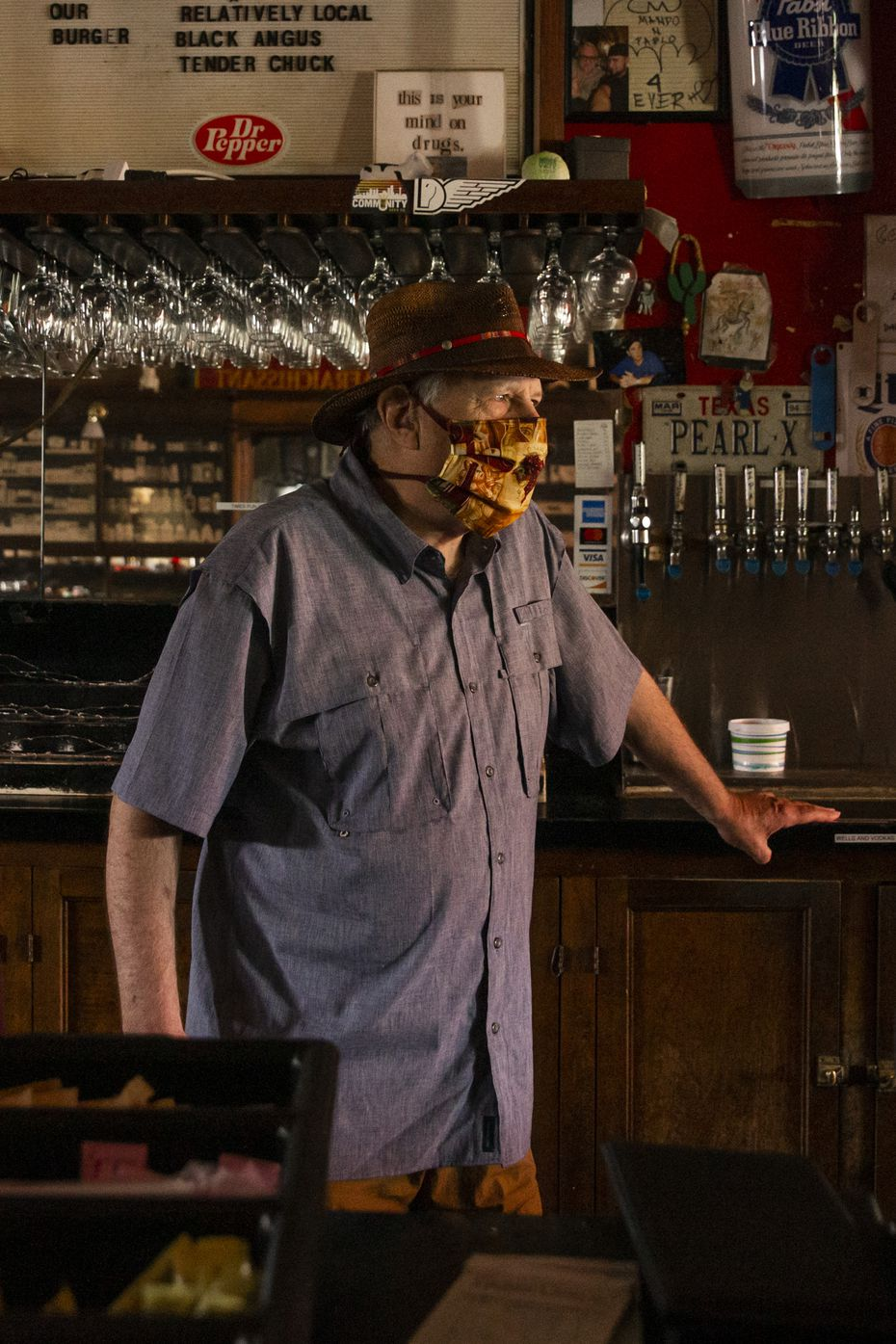 Stoneleigh P owner Tom Garrison is pictured here on June 26, 2020, when bars shut down across Texas. His bar has since reopened and is operating with a food and beverage certificate from TABC.