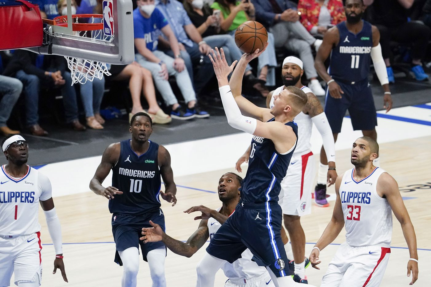 Dallas Mavericks center Kristaps Porzingis (6) shoots over LA Clippers forward Kawhi Leonard (2) during the first quarter of an NBA playoff basketball game at American Airlines Center on Friday, May 28, 2021, in Dallas.