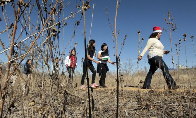 Fifth grade students, and their teachers, from Stevens Park Elementary School hike the nature trails at the Trinity River Audubon Center in Dallas.