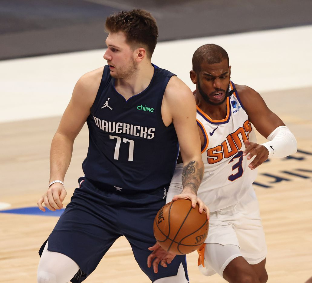 Phoenix Suns guard Chris Paul (3) steals the ball from Dallas Mavericks guard Luka Doncic (77) during the fourth quarter of play at American Airlines Center on Monday, February 1, 2021in Dallas. The Dallas Mavericks lost to the Phoenix Suns 109-108. (Vernon Bryant/The Dallas Morning News)