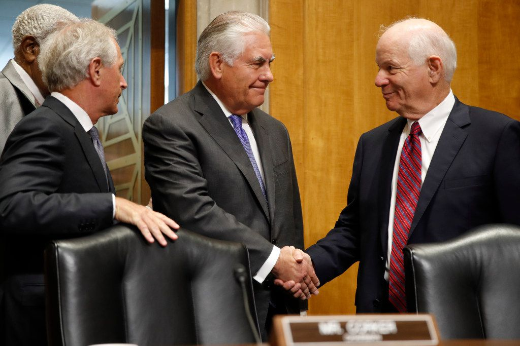 Secretary of State Rex Tillerson (center) is greeted on Capitol Hill in Washington on Tuesday by Senate Foreign Relations Committee Chairman Sen. Bob Corker , R-Tenn. (left), and the committee's ranking senator, Ben Cardin, D-Md., before testifying before the committee.