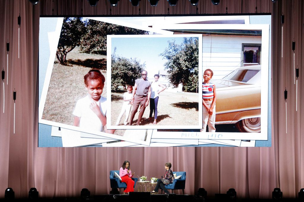 Former first lady Michelle Obama shared stories of her childhood in Chicago during her discussion, in which she was joined by Valerie Jarrett, at American Airlines Center on Monday.