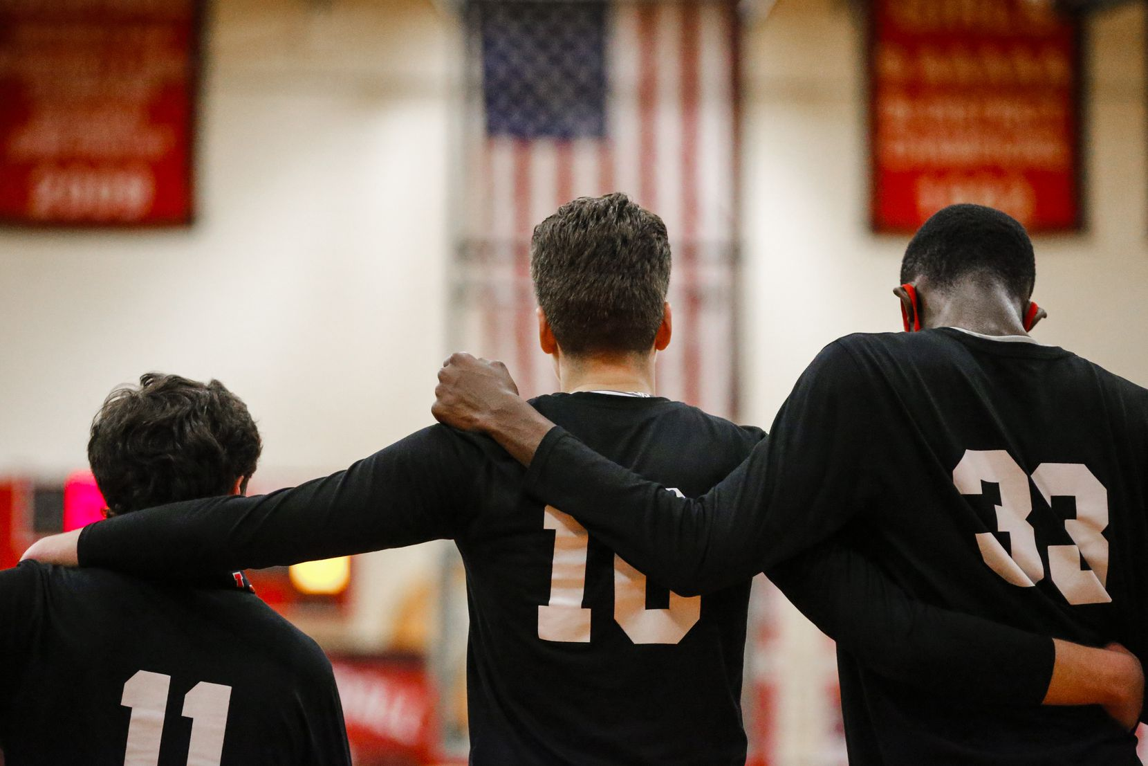 Lake Highlands senior forward Mohamad Shamait (10) stands with his teammates during the National Anthem before a high school basketball game against Irving Nimitz, Friday, February 5, 2021. Lake Highlands won 75-45.  Shamait and his family originally lived in Syria but fled to escape civil war within the country. They moved to Jordan, before finally arriving in the United States.