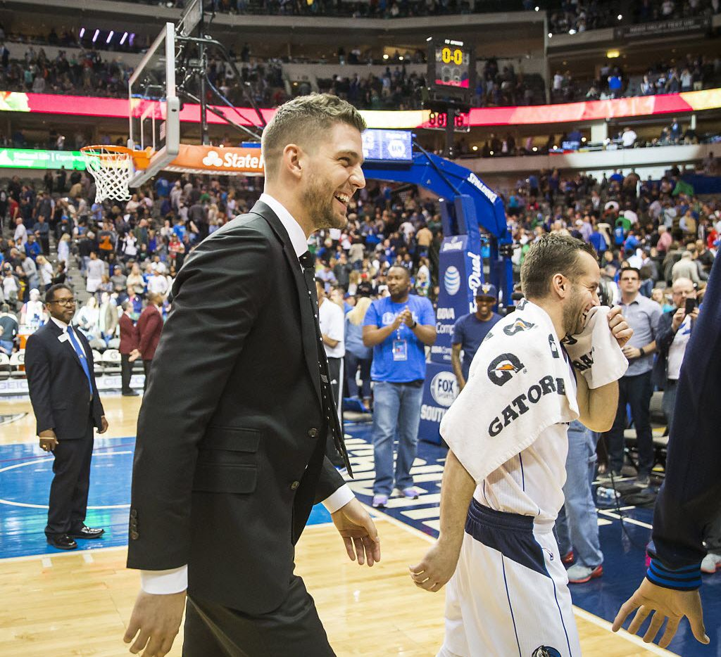 Injured Dallas Mavericks forward Chandler Parsons leaves the court with guard J.J. Barea following a victory over the Portland Trail Blazers in an NBA basketball game at American Airlines Center on Sunday, March 20, 2016, in Dallas. (Smiley N. Pool/The Dallas Morning News)