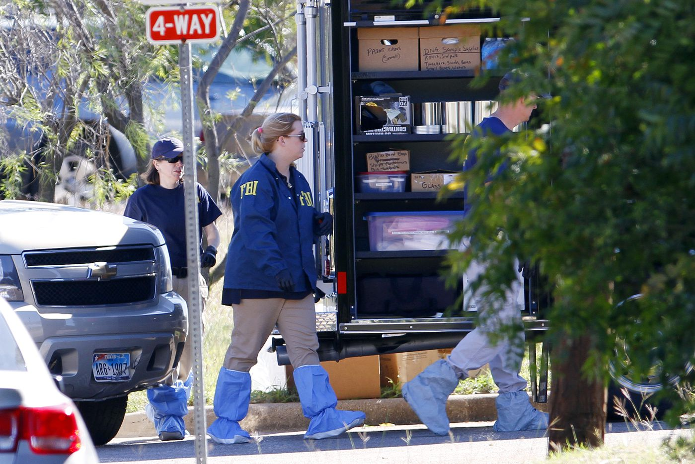 FBI investigators get dressed in protective suits as they work a crime scene where the body of a child was found near the home of missing girl Sherin Mathews, Sunday, Oct. 22, 2017. Ben Torres/Special Contributor