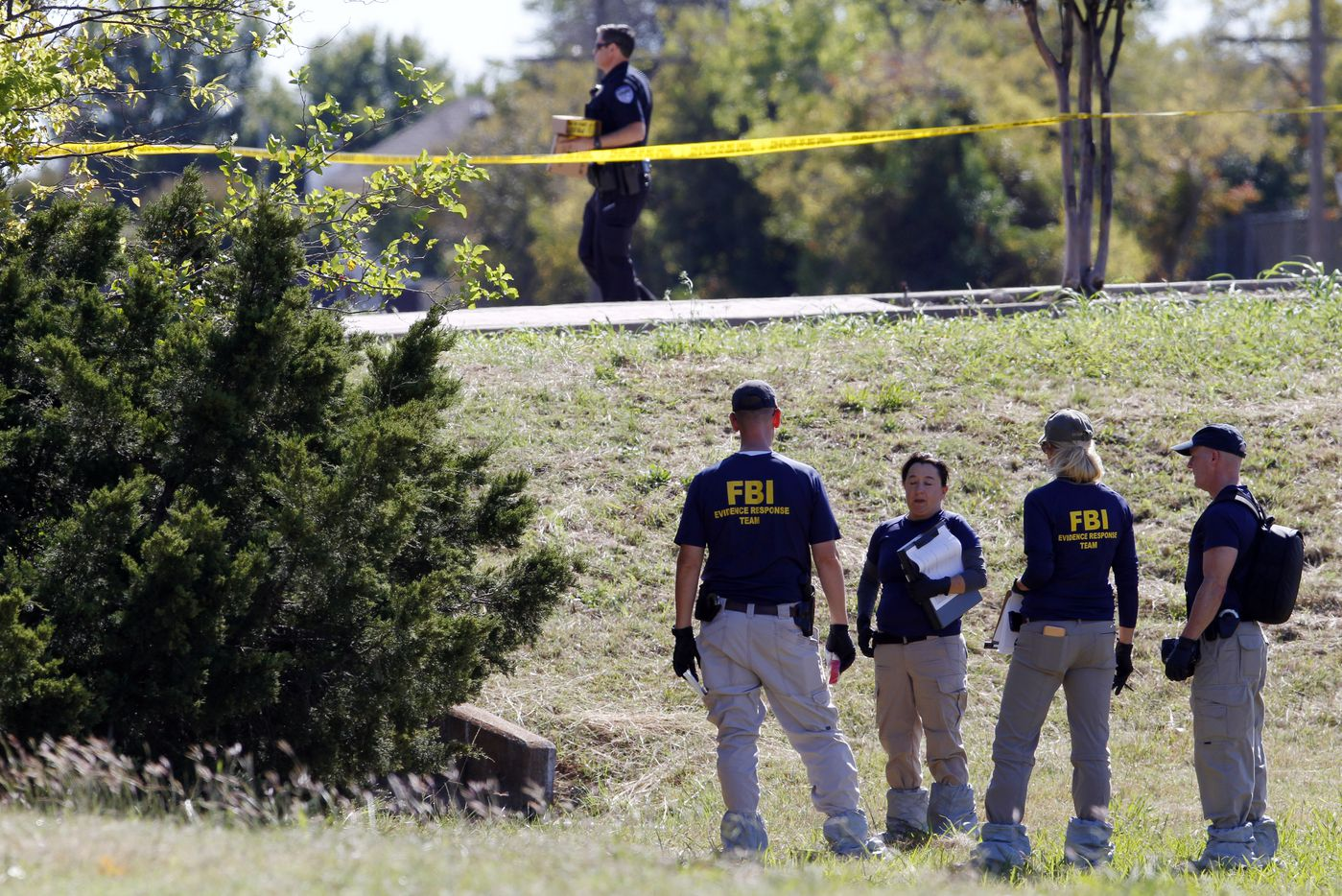 FBI investigates search a grass area near a storm drain after a body of a child was found near the home of Sherin Mathews, Sunday, Oct. 22, 2017. Ben Torres/Special Contributor