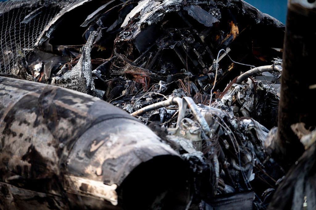 Part of the burned wreckage of a plane on which Dale Earnhardt Jr., his wife and daughter were riding is seen after a crash landing near Elizabethton Municipal Airport in Elizabethton, Tenn., Thursday, Aug. 15, 2019. Everyone on board made it out of the plane. (Calvin Mattheis/Knoxville News Sentinel via AP)