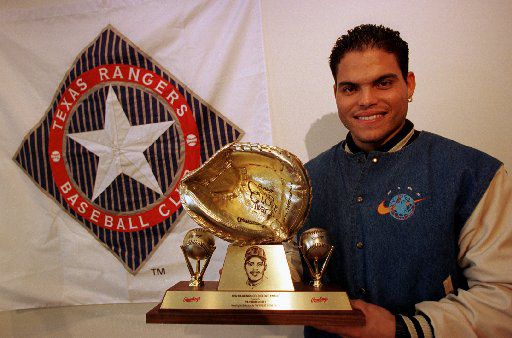 ORG XMIT:  [AMN_08_pudge_96044_JMK ]  Headline:    Caption: 10/8/96---Texas Rangers catcher Ivan  Rodriguez holds the 1992 Gold Glove Award after Tuesday's ceremony announcing he had won the fielding award again this year.    Photographer:    Title: Credit:    City:    State:     Country:    Date: ObjectName: AMN_08_pudge_96044_JMK CaptionWriter:    Special:    Category: SupCat1:    SupCat2:     SupCat3:    Source: Keyword: Arlington Morning News   Keyword: AMN_08_pudge_96044_JMK   Keyword: 96044   Keyword: JMK_J. Mark  Kegans   Keyword: Gold Glove Award Keyword: Ivan Rodriguez     Keyword: Texas Rangers Keyword: 10/8/96   Keyword: DMN STAFF    Keyword: 100996   Keyword: IVAN RODRIGUEZ   Keyword: PUDGE