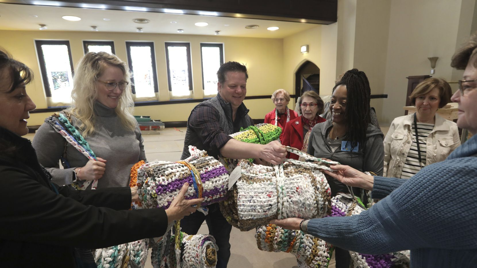 Members of CC Young Senior Living deliver crocheted mats made from plastic bags to members of the Oak Lawn United Methodist Church in Dallas, on Jan. 27, 2020.
